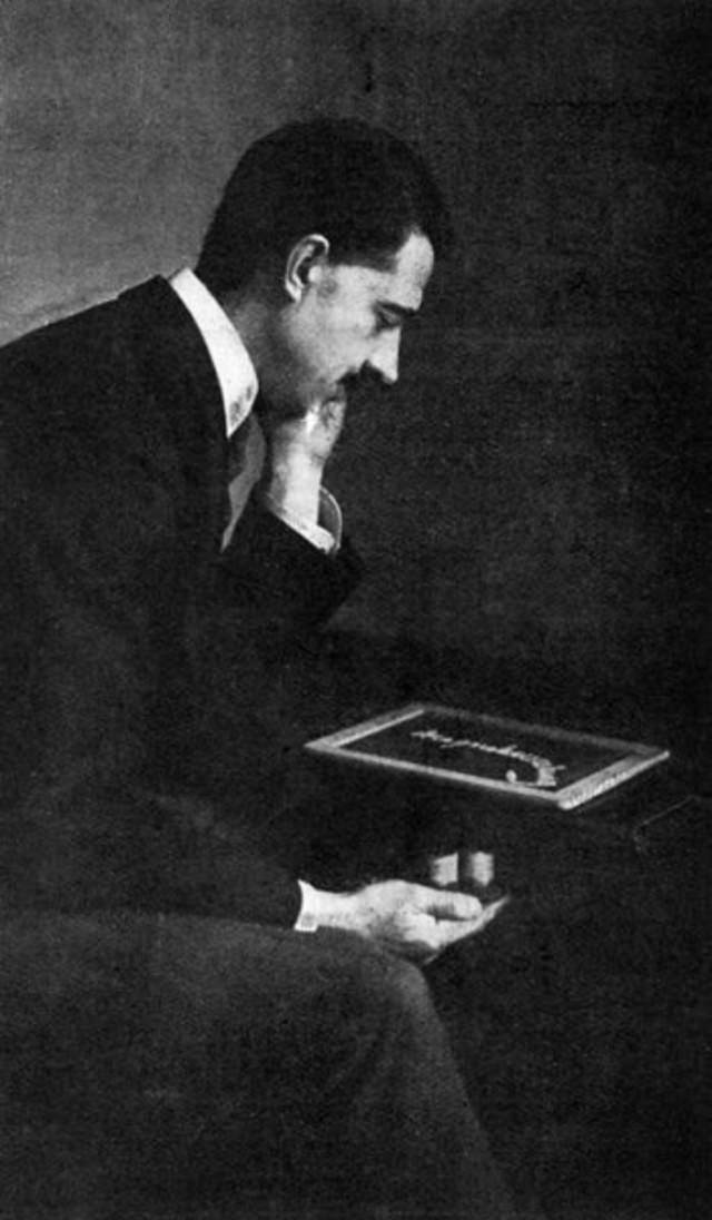 William Marriott demonstrating a slate writing trick.