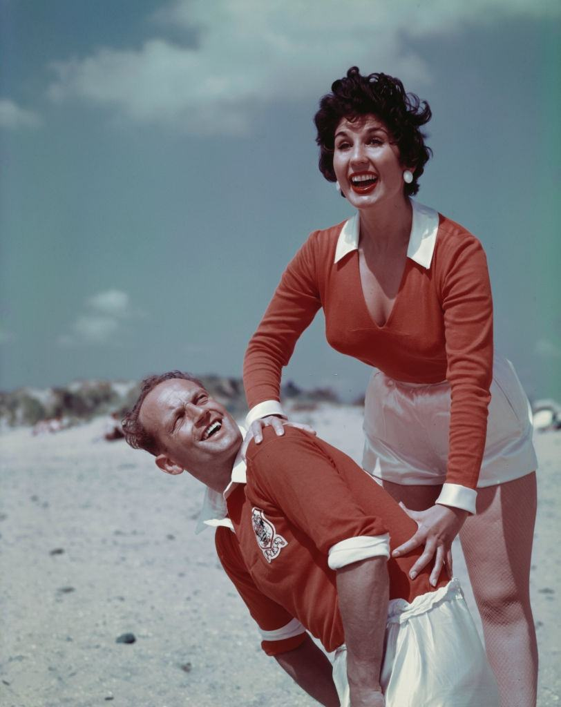English singer Alma Cogan  with English footballer and captain of Blackpool FC, Harry Johnston on Blackpool, England in August 1955.
