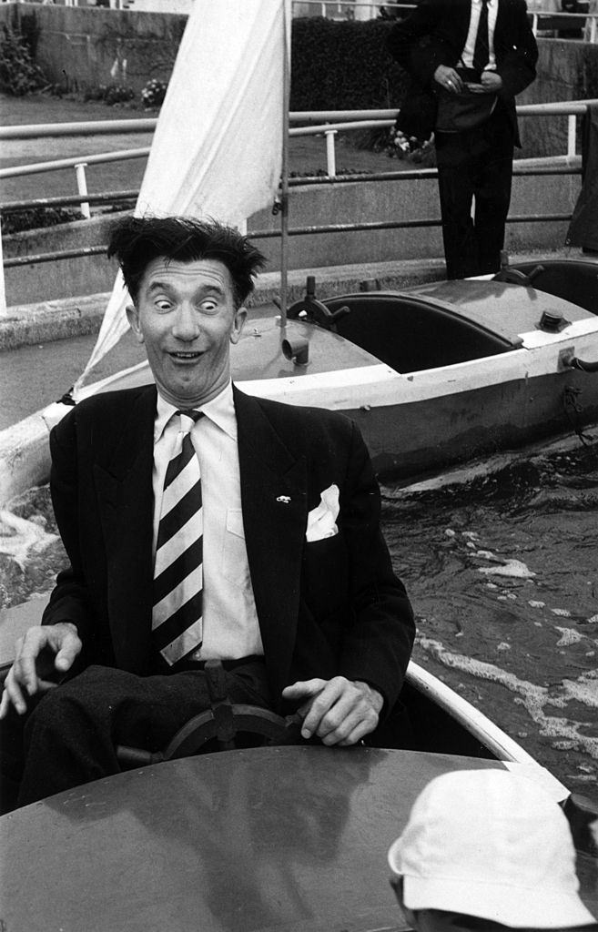 Blackpool comedian Nat Jackley taking his son for a ride on the Pleasure Beach, 1953.