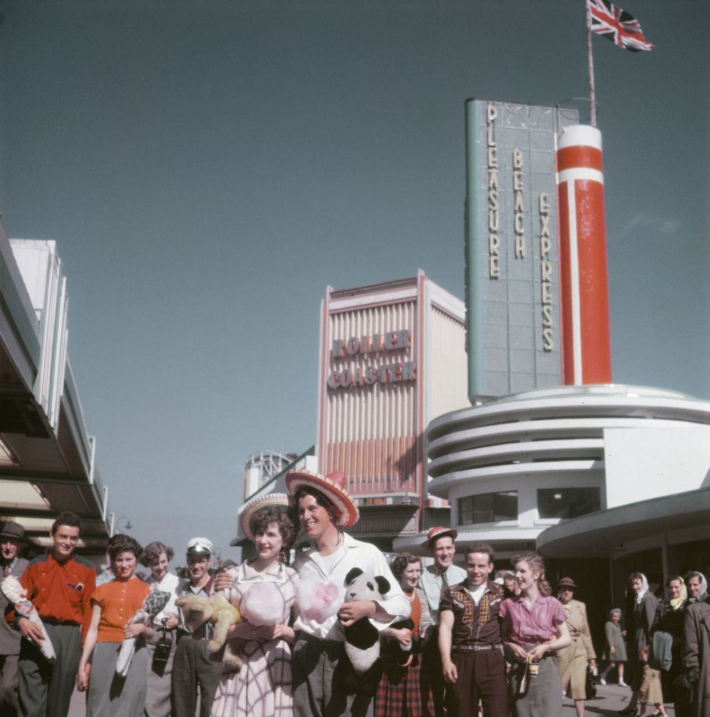 Visitors and holidaymakers enjoy a trip to Blackpool Pleasure Beach amusement park in the seaside resort of Blackpool, Lancashire in July 1952.