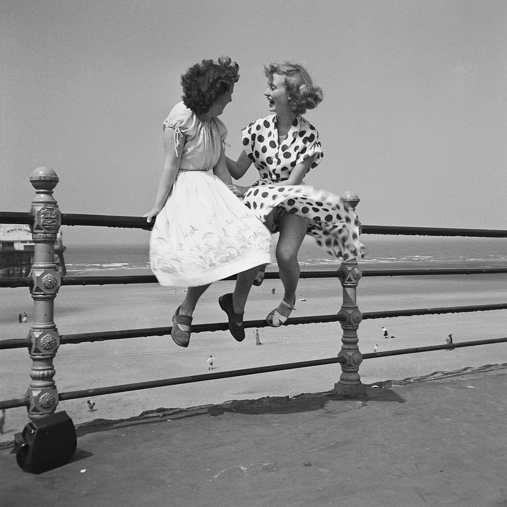 wo women chatting on the railings in Blackpool, 1951.
