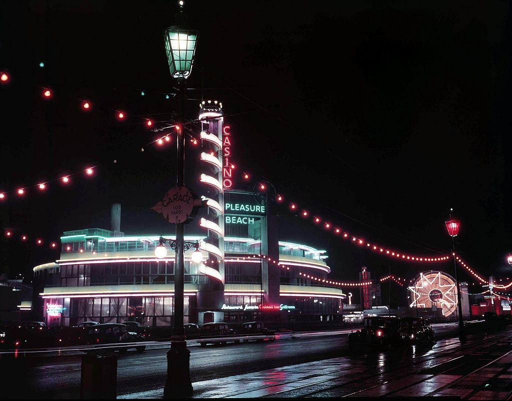 View of the casino and pleasure beach buildings lit up during the Blackpool Illuminations annual lights festival in the seaside resort of Blackpool, 1950.