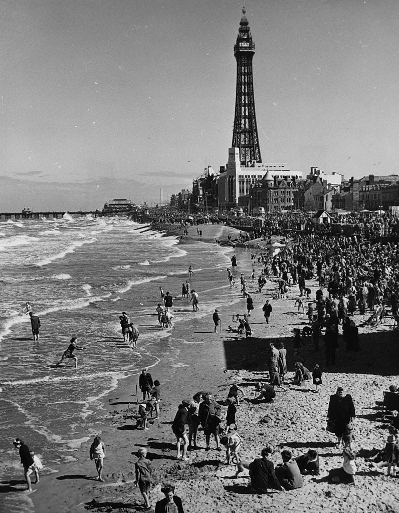 Crowds of day-trippers on the beach at Blackpool, Lancashire, 1955.