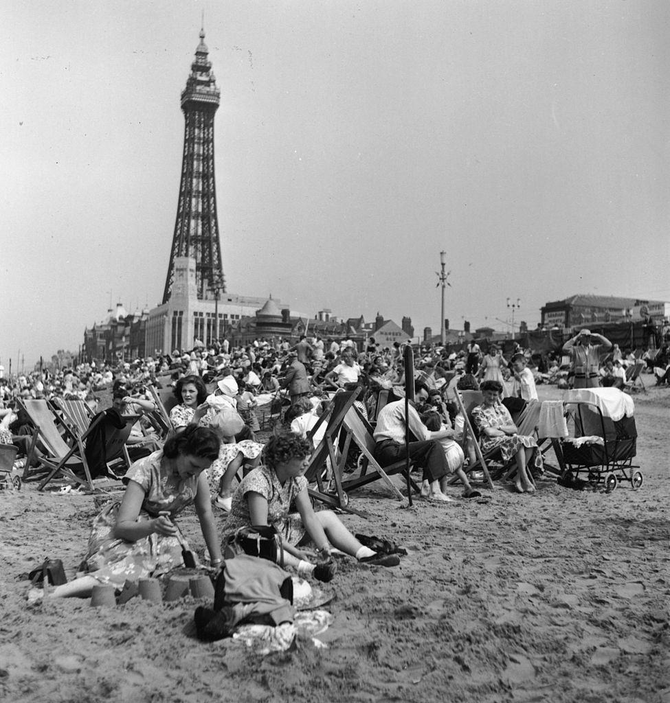 Holidaymakers on the beach at Blackpool during Wakes Week, the annual holiday for workers in the industrial north, July 1955.