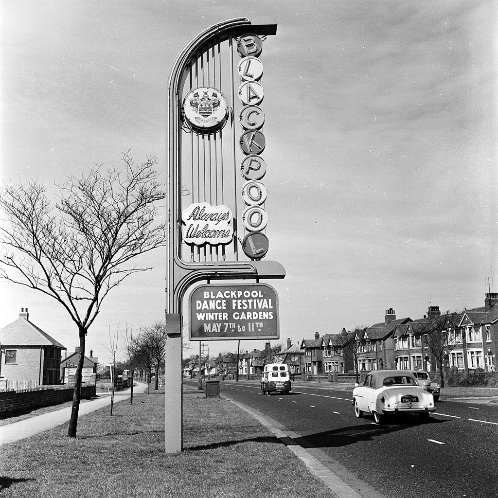 A sign welcomes visitors to a dance festival in Blackpool seaside resort, 1956.