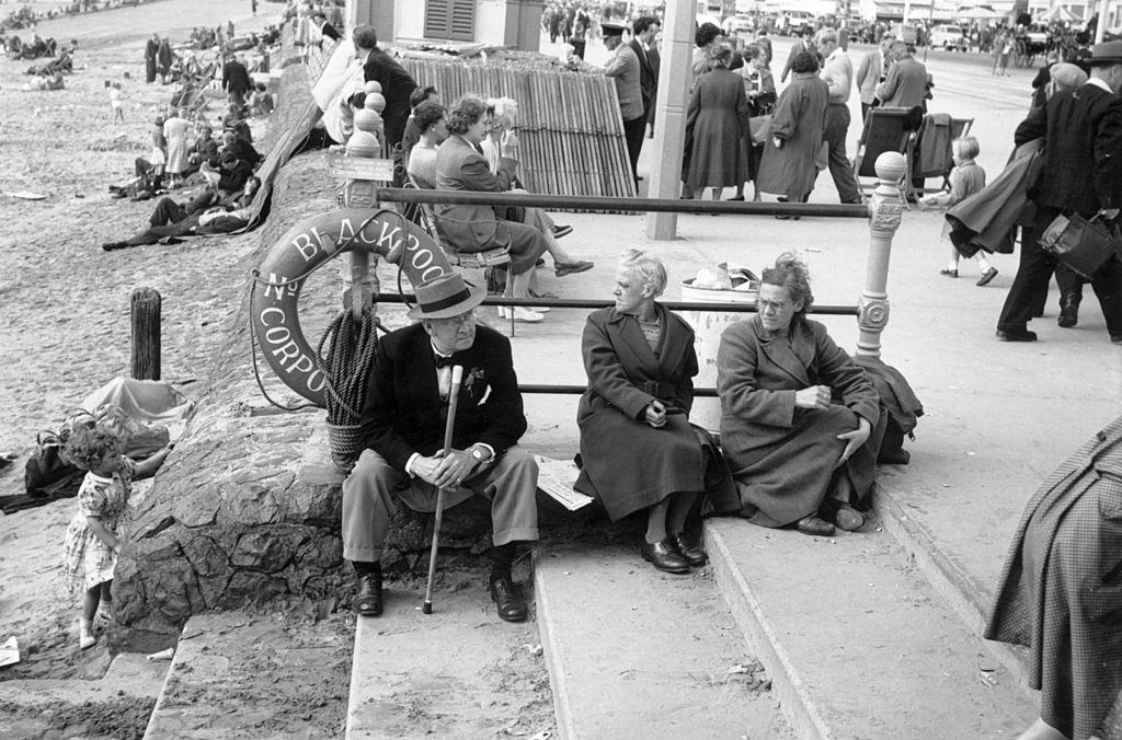 Taking advantage of the spell of good weather, holiday makers enjoy themselves on the beach at Blackpool, 1956.