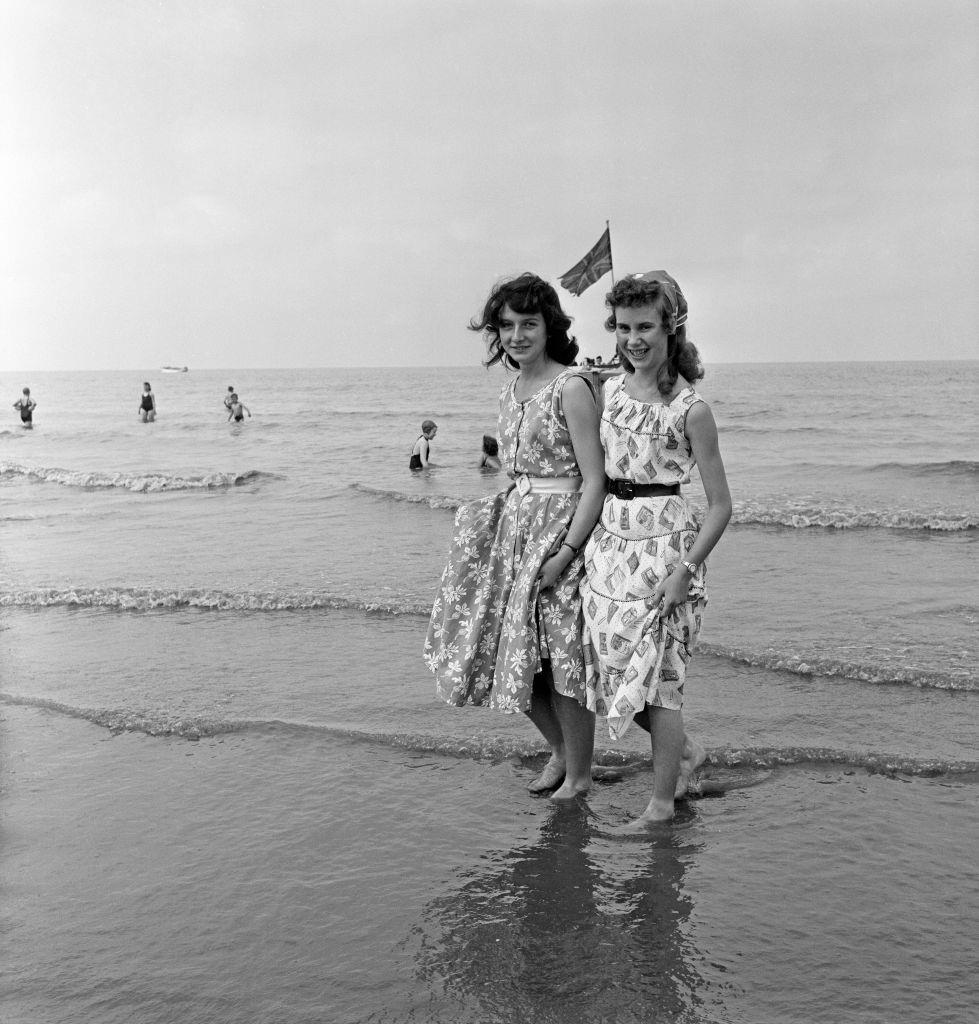 Margaret Wright and Ethel Foster of Wigan paddling in the sea at Blackpool, 1957.
