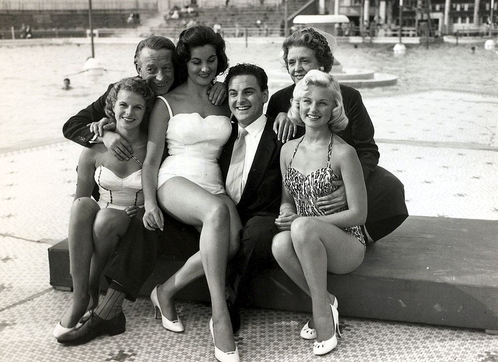 British comedian Bob Monkhouse, centre with Wilfred and Mabel Pickles and beauty contestants at a beauty show at Blackpool, 1957.