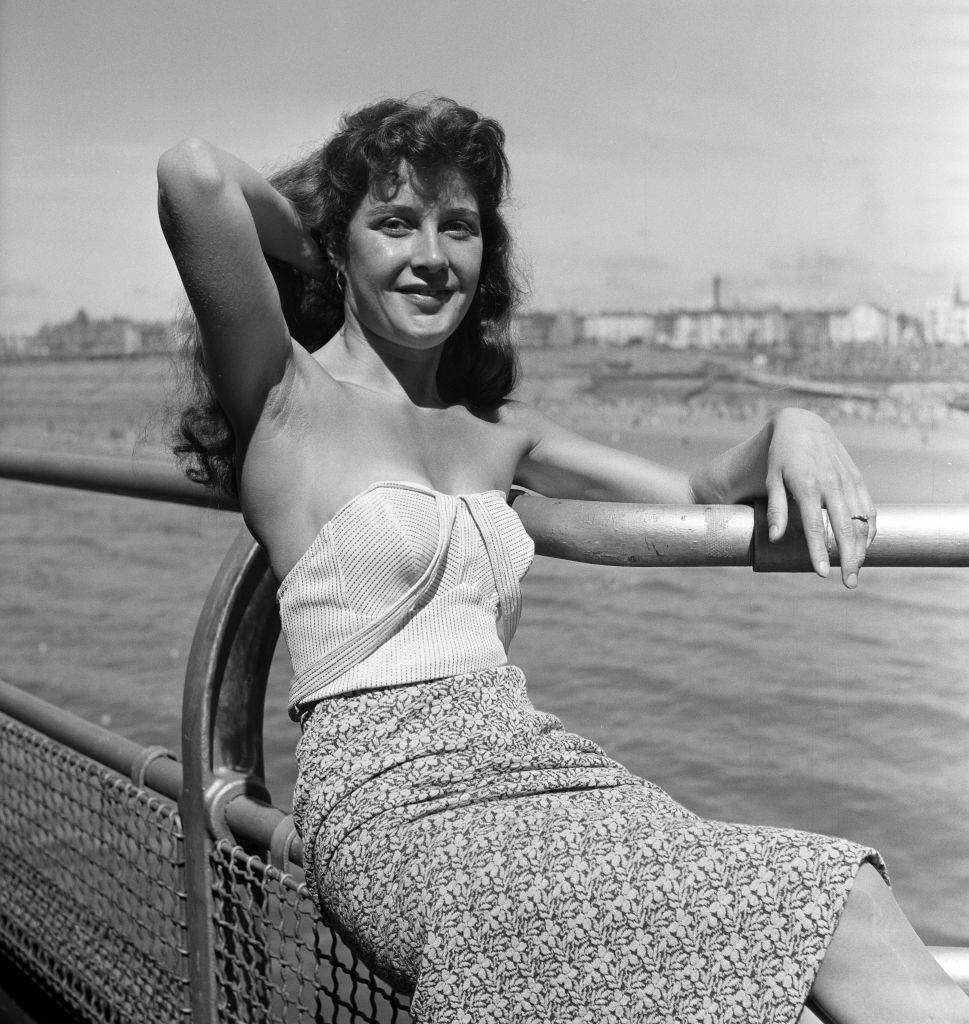 A 22-year-old Veronica Cliff sitting on the rails at Blackpool, 1958