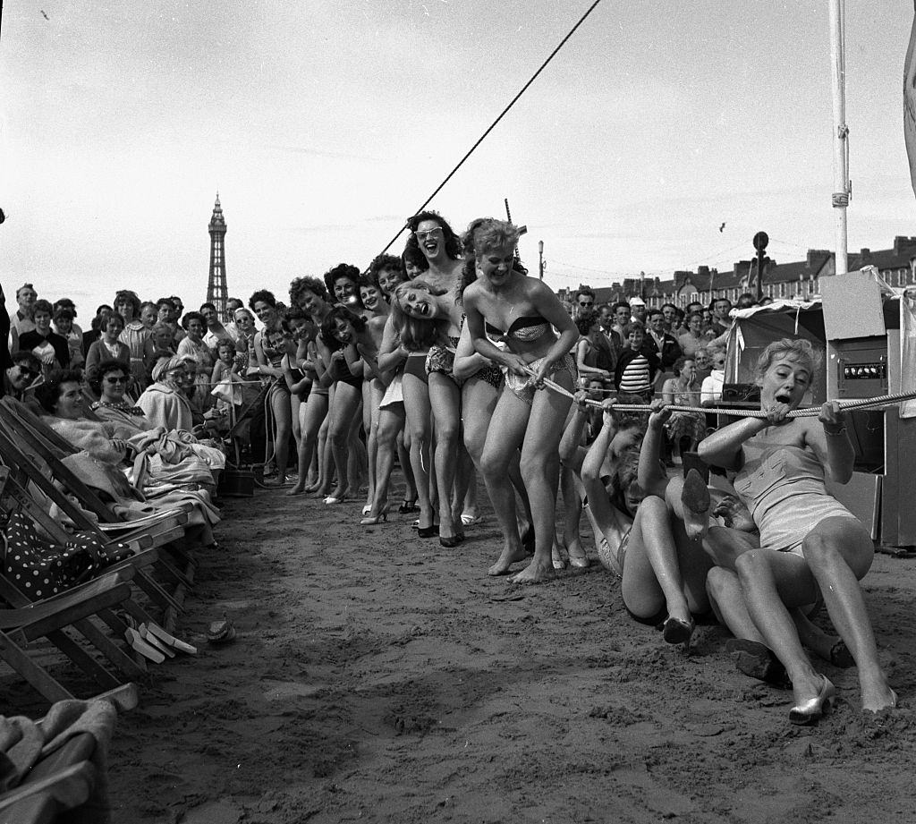 Sunday pictorial beach contest at Blackpool. Competitors take part in a game of tug o war, 1958