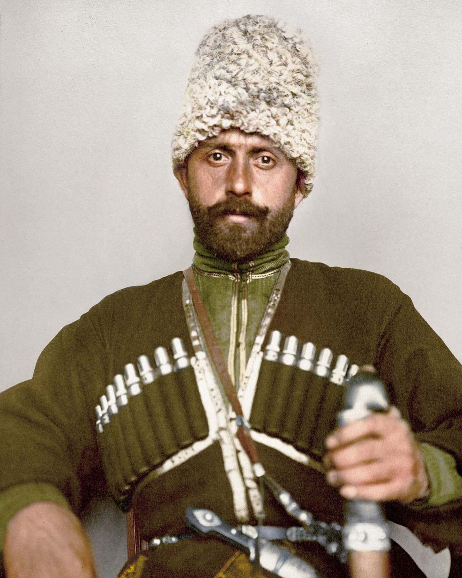 """Cossack man."""" The Cossacks were famed soldiers that, by the time of this photograph, had evolved into a military class that served as border guards or police. A Cossack soldier was required to provide his own arms, horses and uniform at his own expense. This man is most likely from the Ussuri Cossac"""