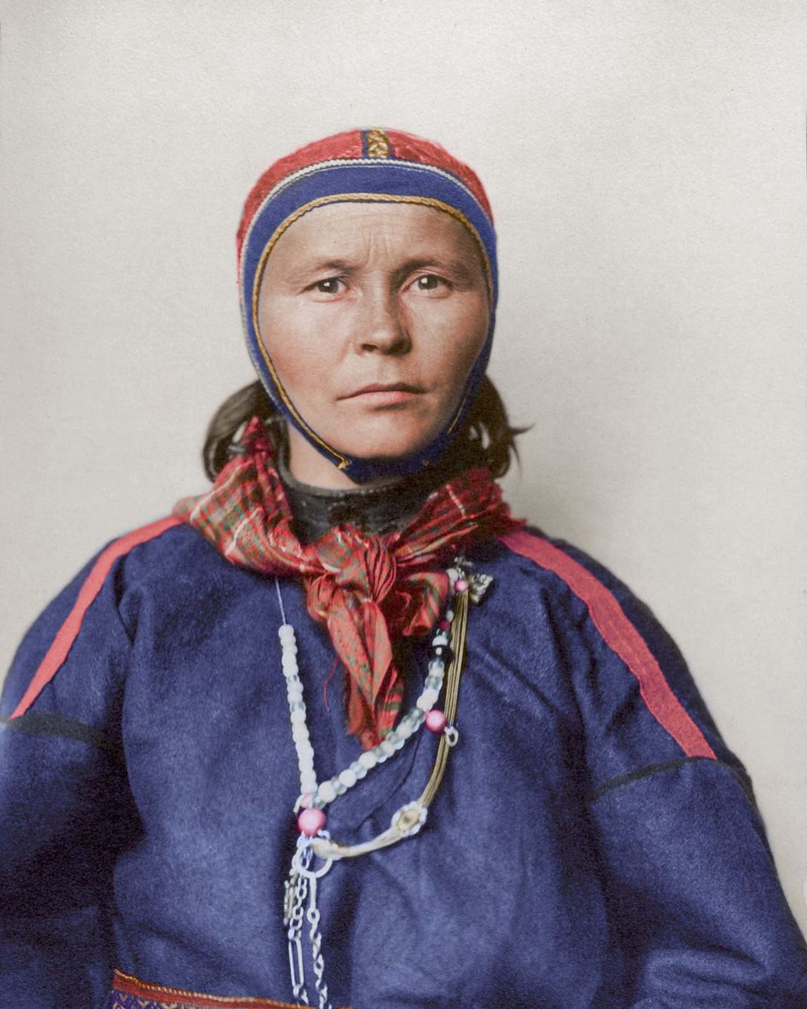 """Laplander."""" Gákti is the traditional costume of the Sámi people, who inhabit the Arctic regions spanning from northern Norway to the Kola peninsula in Russia. Traditionally made from reindeer leather and wool, velvet and silks are also used, with the (typically blue) pullover being supplemented by c"""