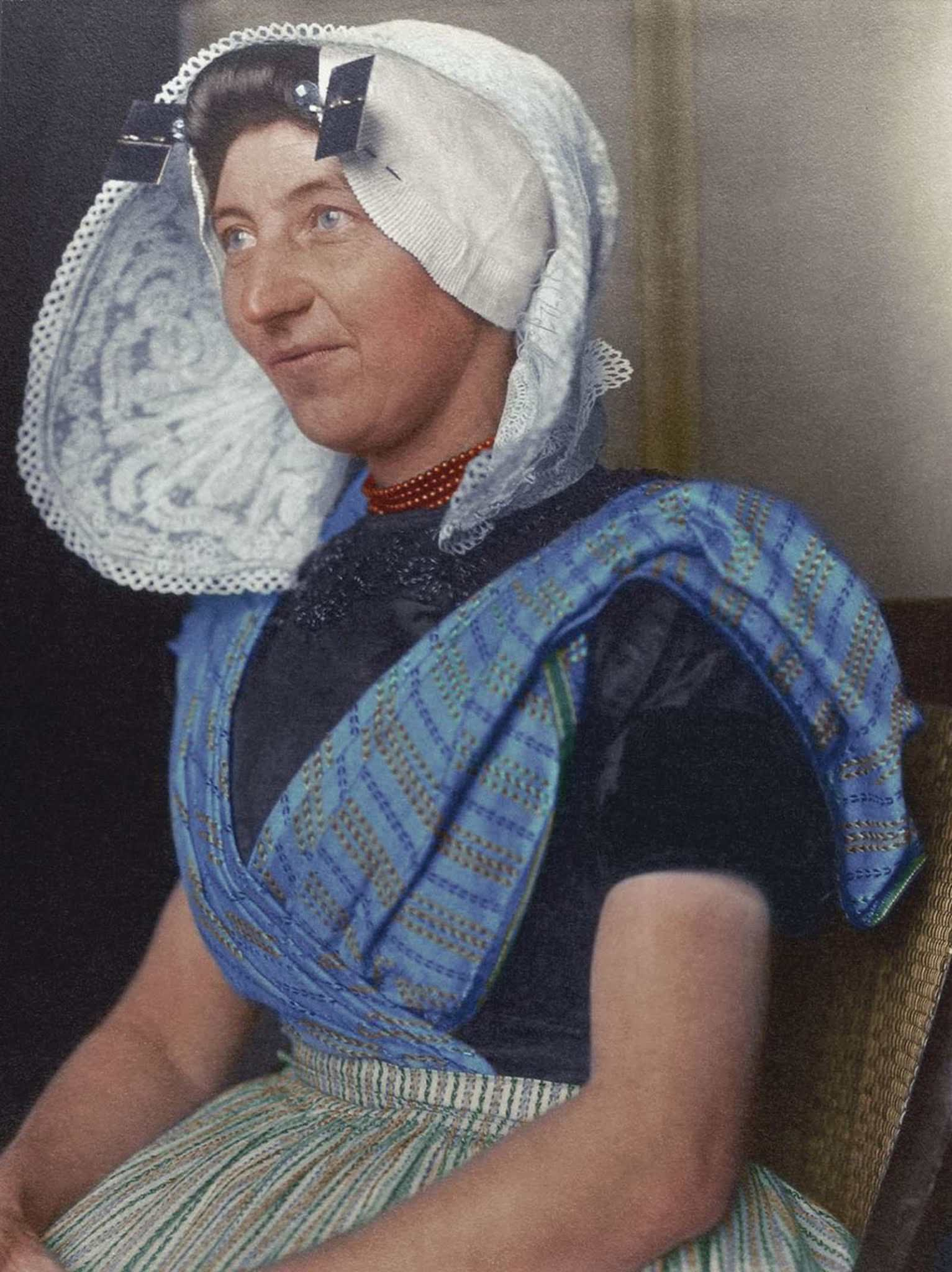 """Dutch woman."""" The large bonnet, which is arguably one of the most recognizable aspects of Dutch traditional dress, was usually made of white cotton or lace and sometimes had flaps or wings, and often came with a cap. The rest of the costume, like so many others, came in distinctly regional variation"""