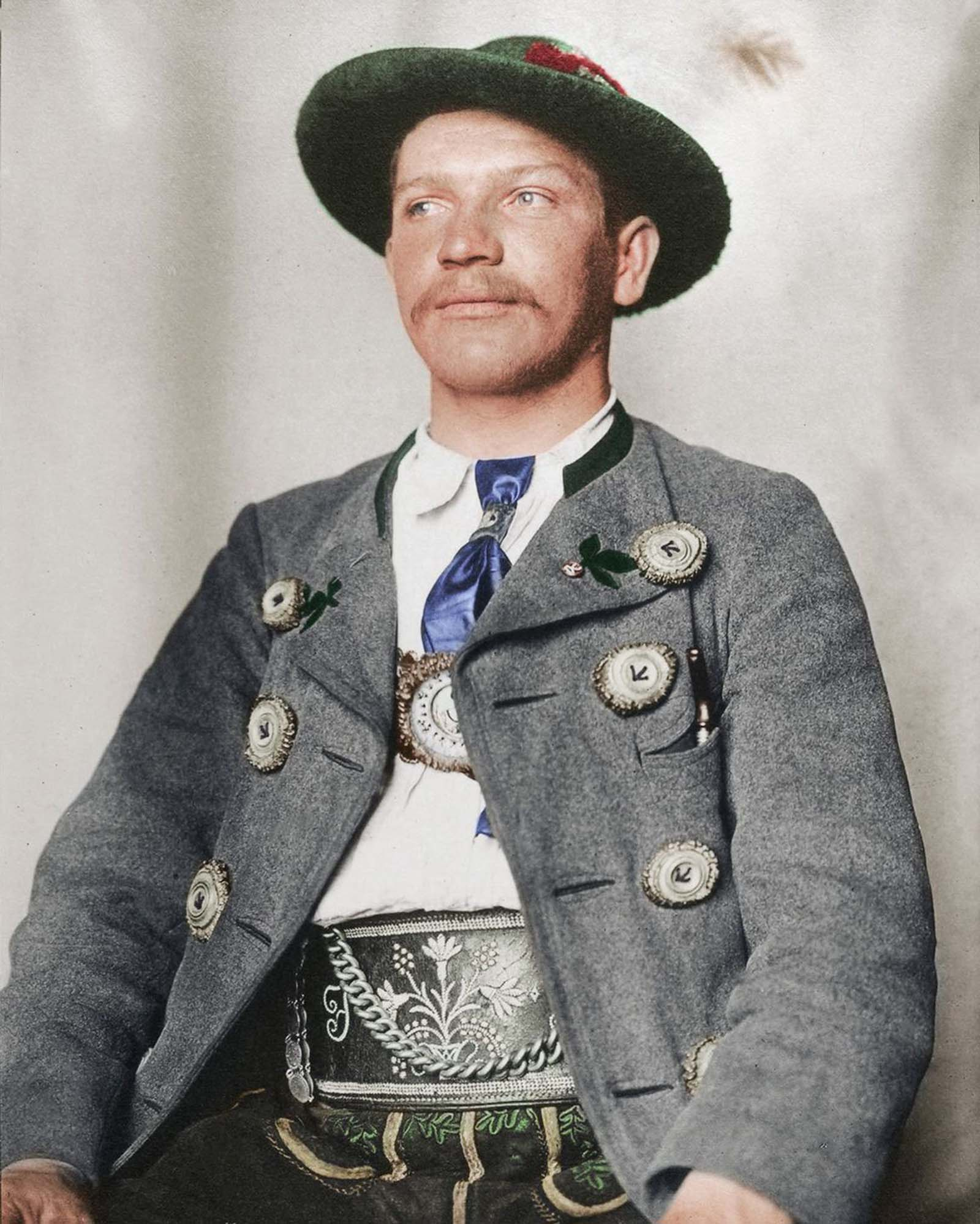 """Bavarian man."""" The traditional dress of Germany is known as the trachten, and like so many others has regional variations. In the alpine regions of Germany like Bavaria, leather breeches known as Lederhosen were worn regularly by rural folk, though in modern-day Germany, most people associate the ga"""