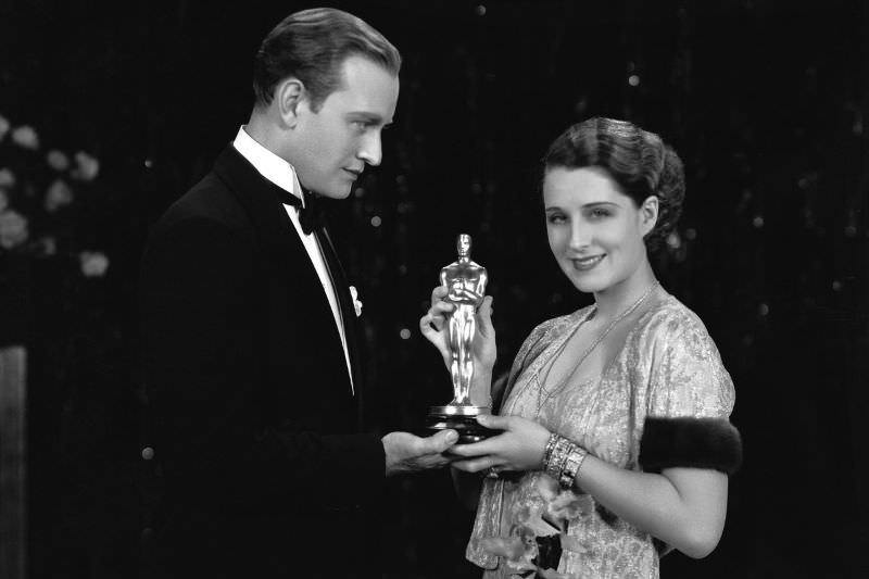 Vice president of the Academy of Motion Picture Arts and Science, Conrad Nigel, presents the Oscar to actress Norma Shearer, 1929