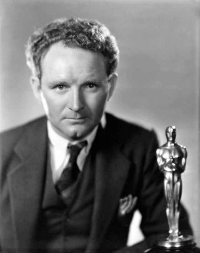 """Best Director Dramatic Picture Frank Borzage poses with his award for """"7th Heaven"""" in 1929"""