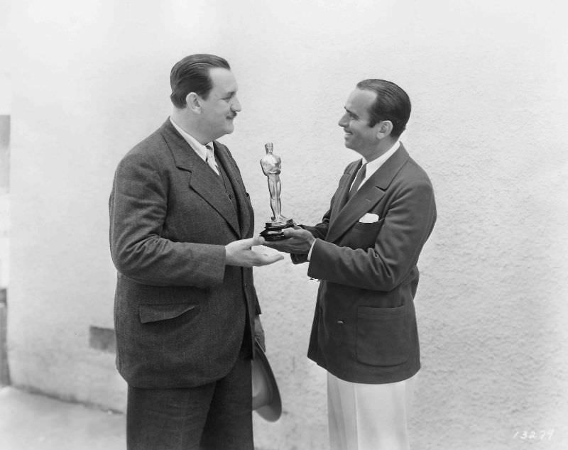 Douglas Fairbanks, who hosted the ceremony, presents Joseph Farnham with his award in 1929