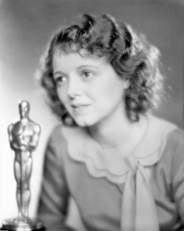 """Janet Gaynor with her award for her performances in """"7th Heaven,"""" """"Street Angel,"""" and """"Sunrise"""" in 1929"""