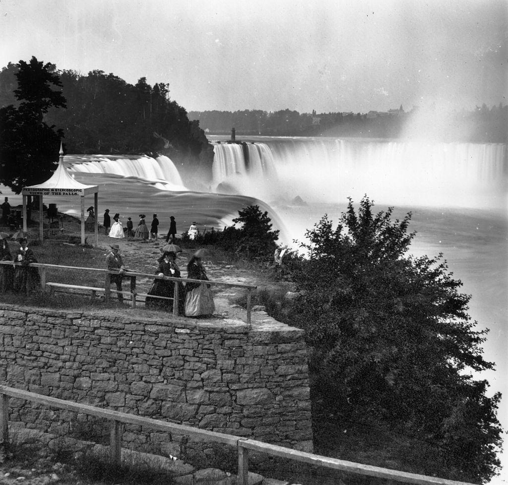 Visitors overlooking Niagara Falls from Prospect Point, on the US bank, 1859.
