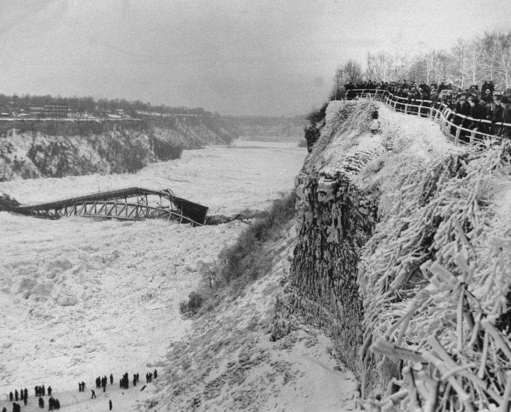 Crowd gathers to see the wreckage of the Falls View Bridge, 1938.