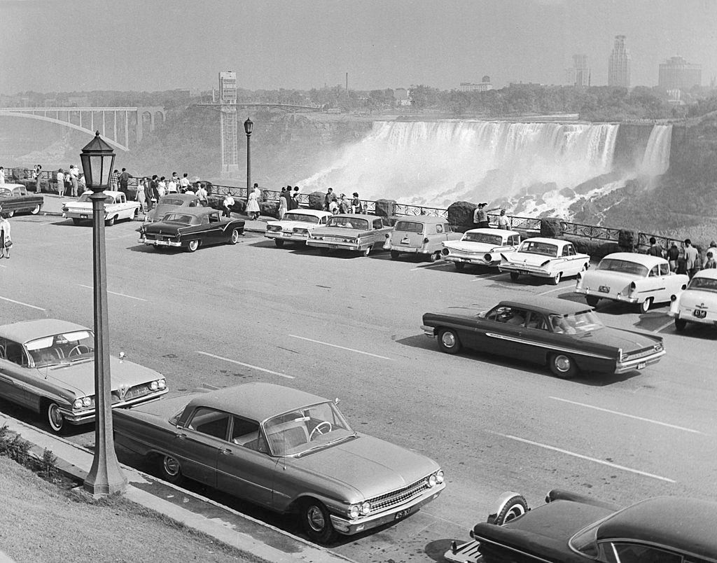 Niagara falls from the Canadian side with the Rainbow Bridge on the left and Bufallo in the Background, 1950.