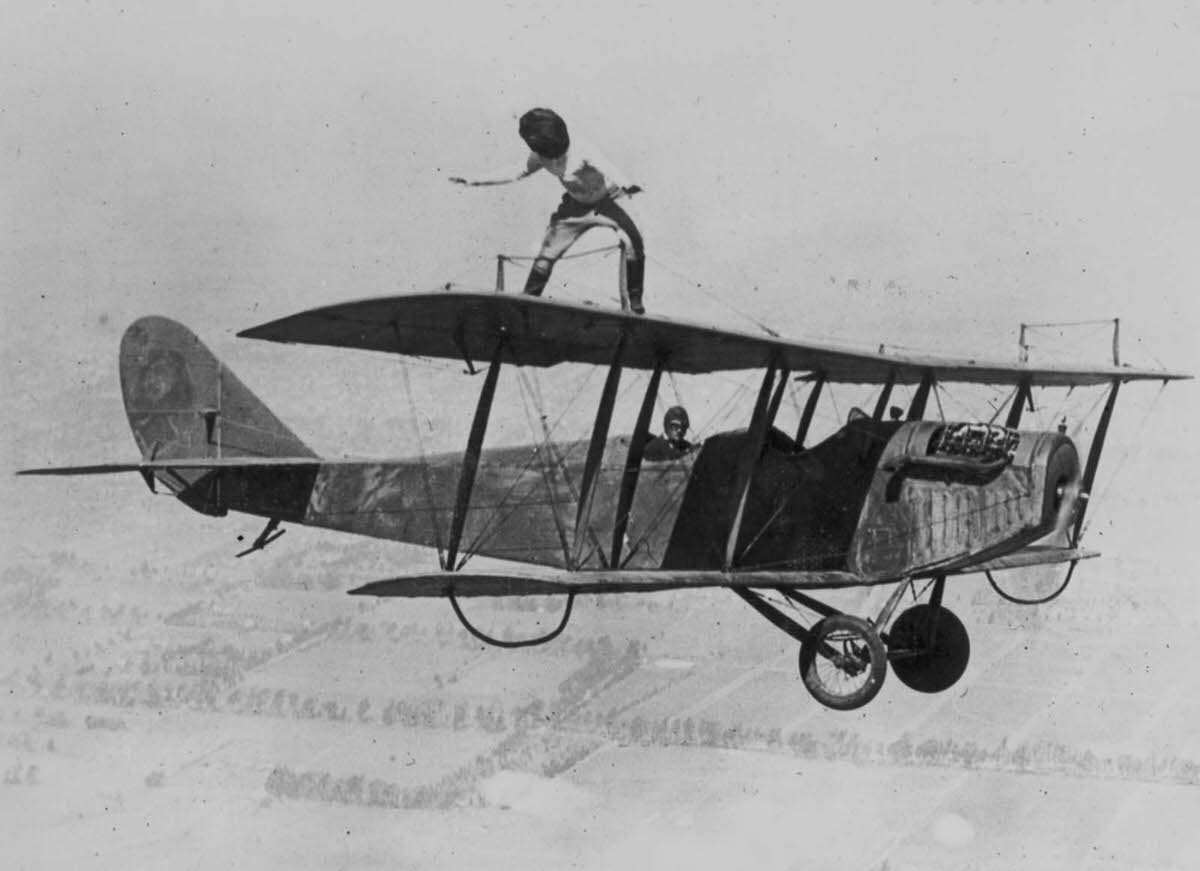 Gladys Roy walks the wings of a Curtiss JN-4 'Jenny' biplane over Los Angeles while blindfolded, 1924.