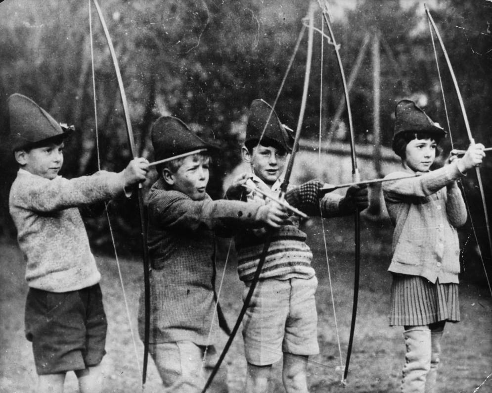 Philip of Greece (second from the left) trying his hand at archery with his schoolmates at the MacJannet American school in France, 1929.