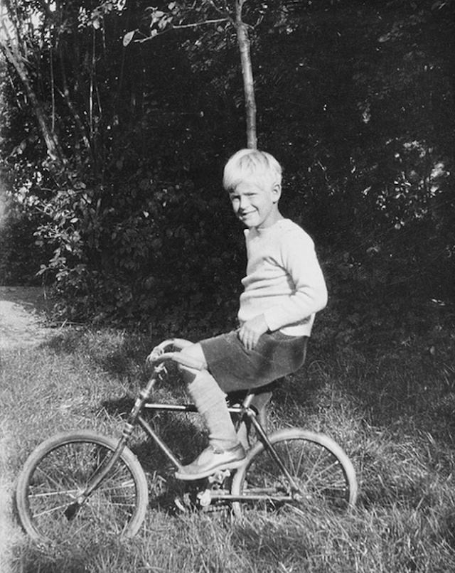 Philip riding a bicycle, 1929.