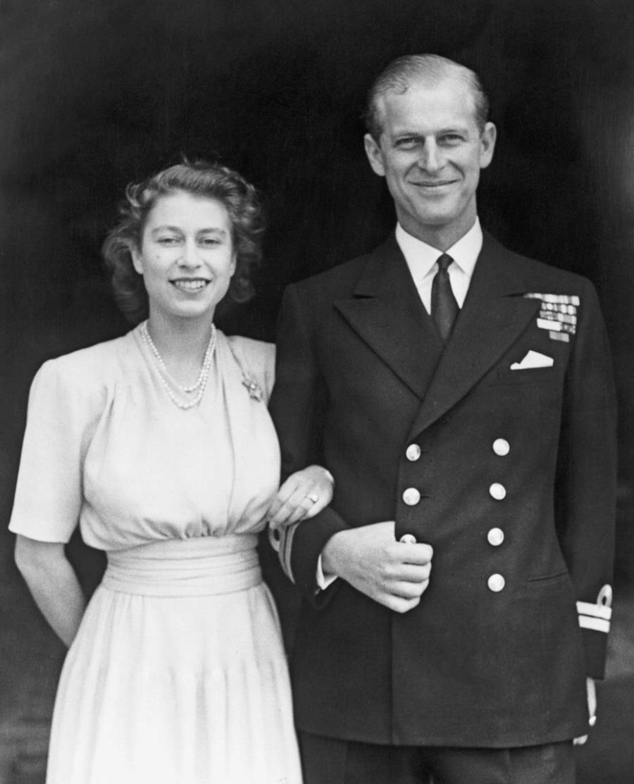 Prince Philip with Princess Elizabeth posing for a photo shortly after they announced their engagement, 1947.