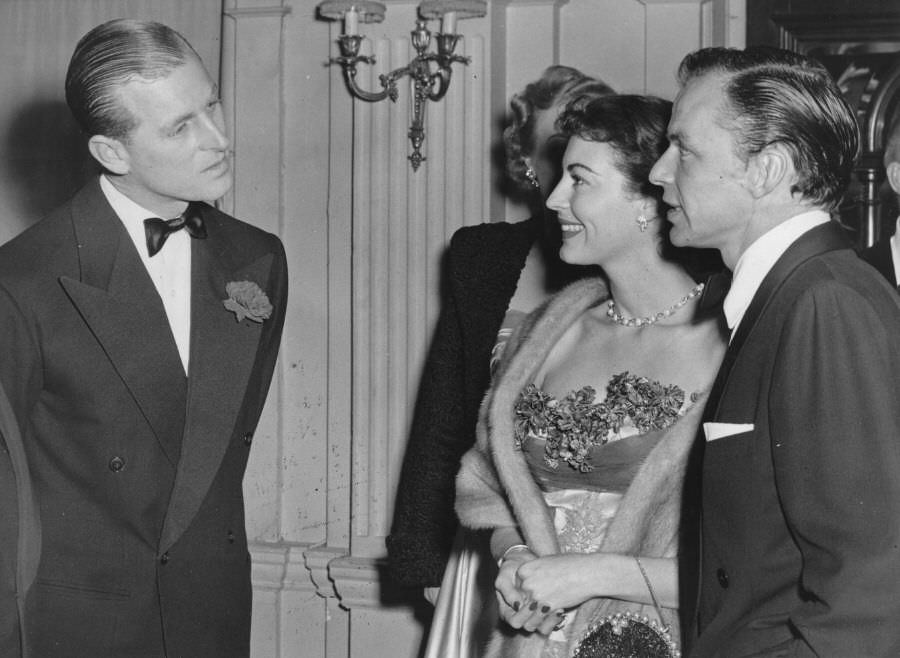 Prince Philip chats with Frank Sinatra and Ava Gardner at London's Empress Club, 1951.