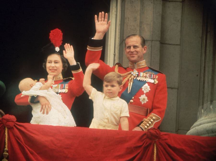 Prince Andrew and Prince Edward give a royal wave alongside their parents during the Trooping the Colour parade, 1964.