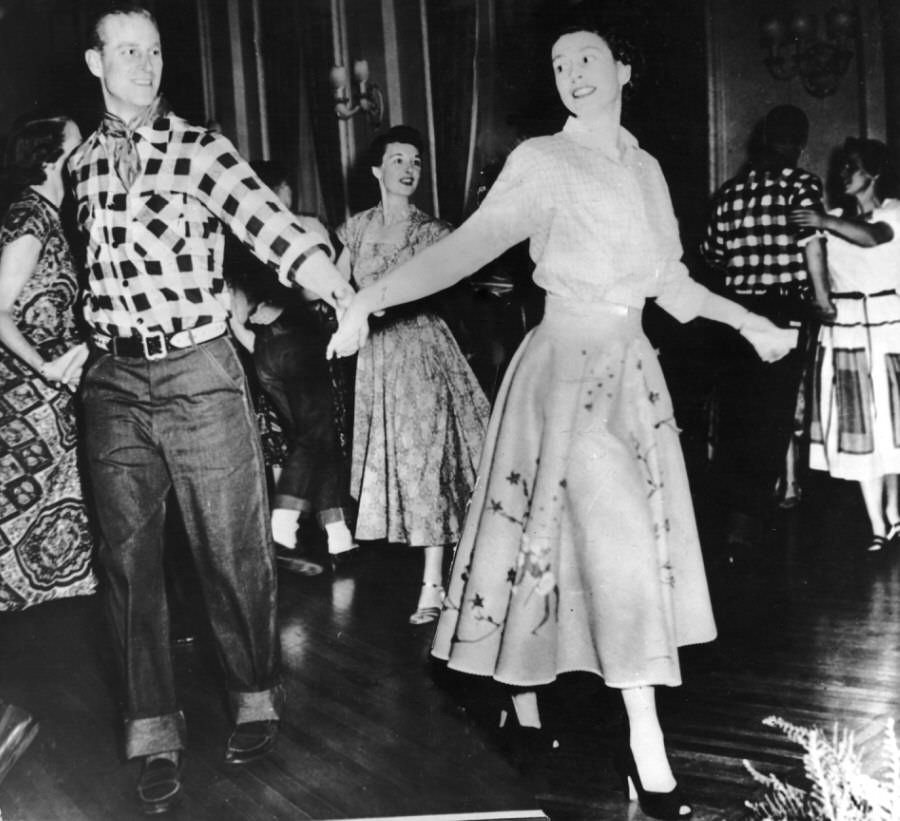 Prince Philip with Princess Elizabeth at a square dance held in their honor in Ottawa.
