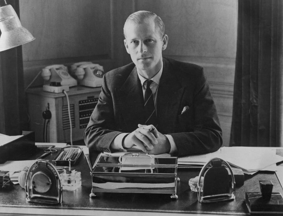 Prince Philip, the Duke of Edinburgh, sitting at his desk at Clarence House, 1951.