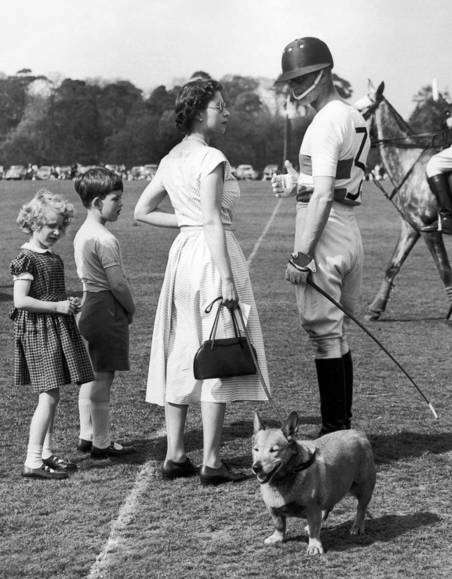 Prince Philip with Queen during a polo game in Windsor Park, 1957.