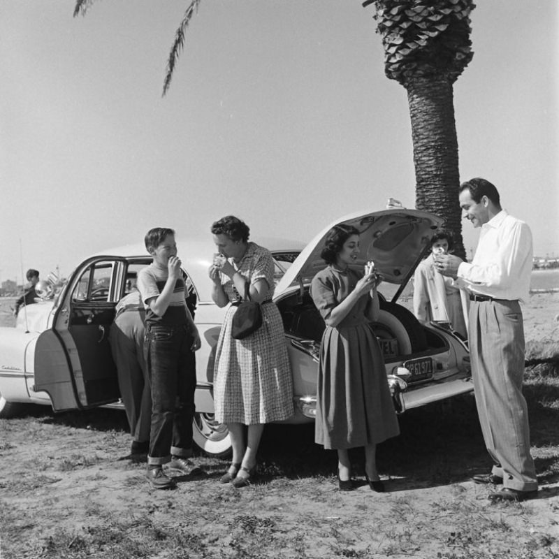 A picnic on the beach, courtesy of Louis Mattar's tricked-out 1947 Cadillac.