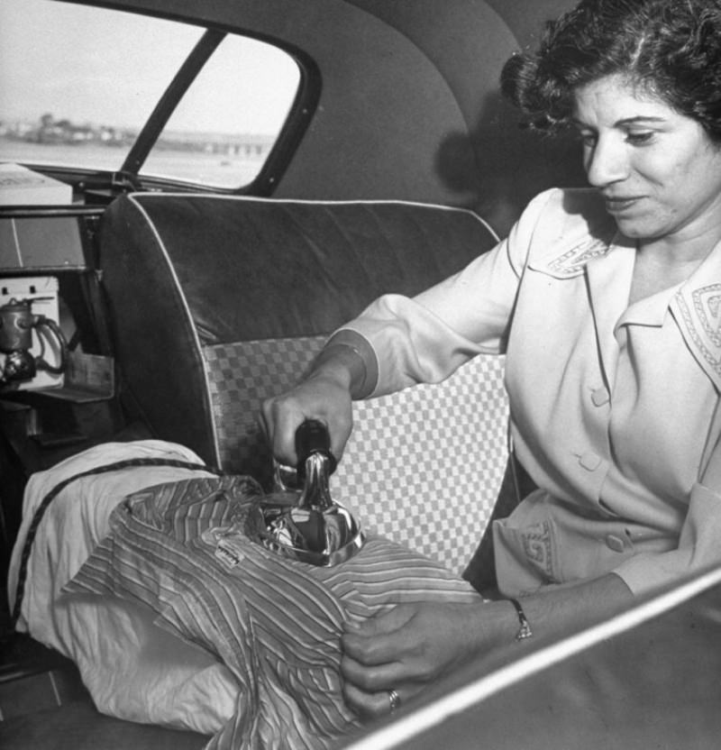 Ironing is easy for Mrs. Mattar with arm rest as board. Toaster or razor can be plugged in here.