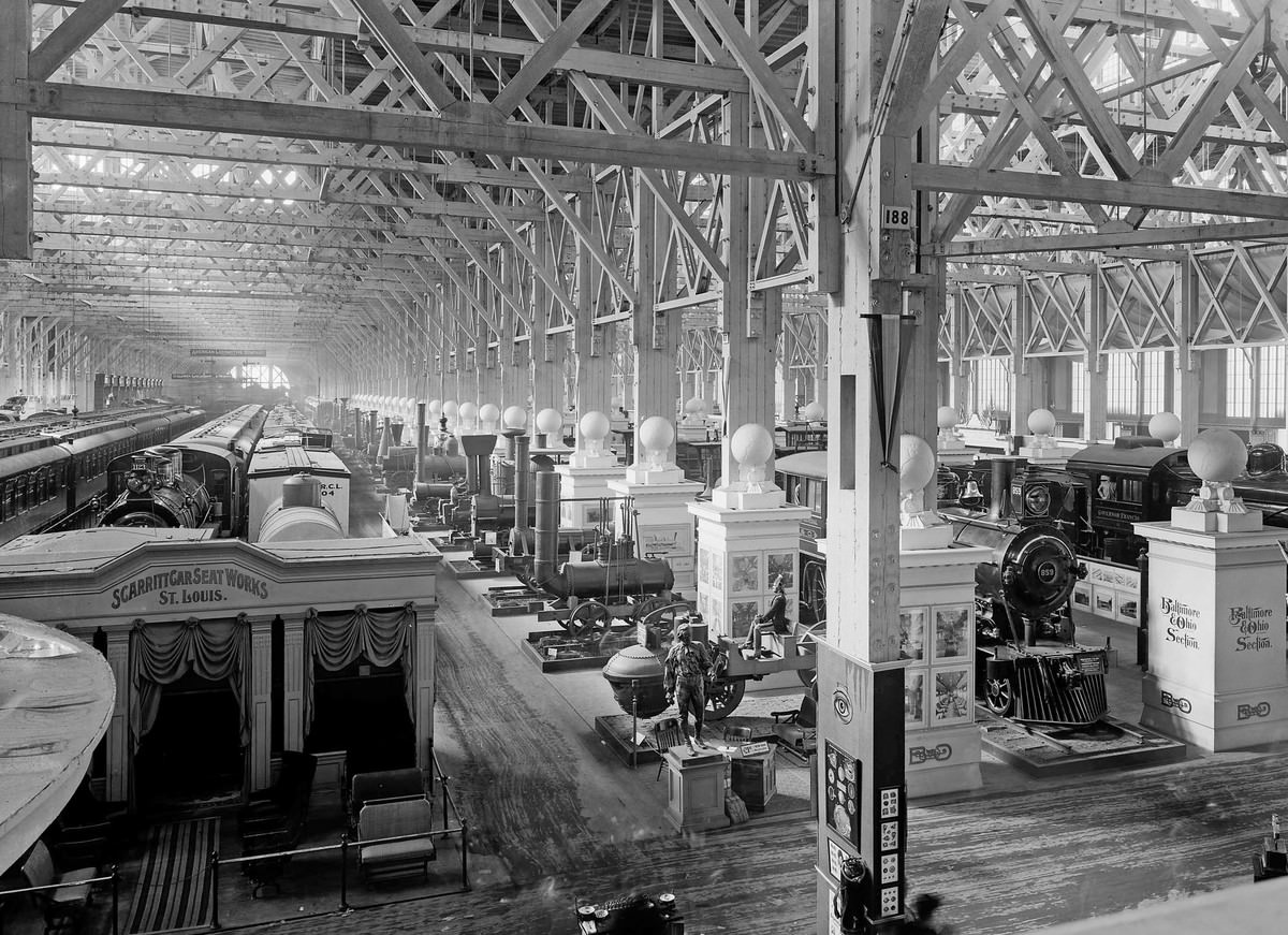 An exhibit of historic locomotive engines fills part of the huge Palace of Transportation.