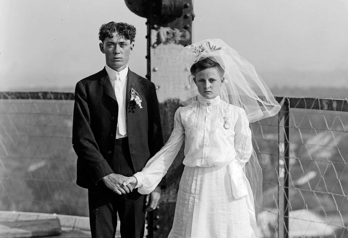 A bride and groom pose for their wedding photograph at the top of the DeForest Wireless Telegraph Tower at the Louisiana Purchase Exposition.