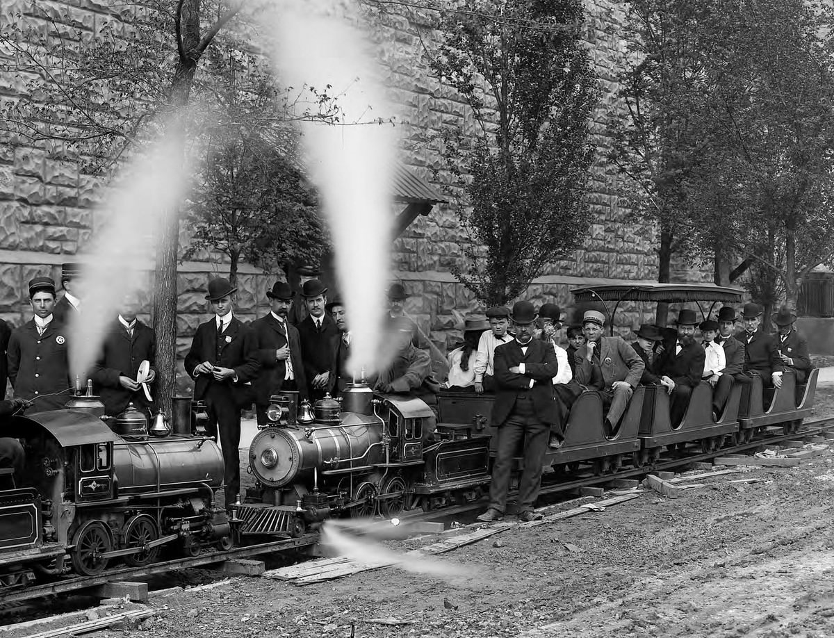 The Miniature Railway concession, operated by the Cagney brothers, ran the full length of the Pike and took passengers to the Boer War concession, the Philippine exposition, and other places of interest.