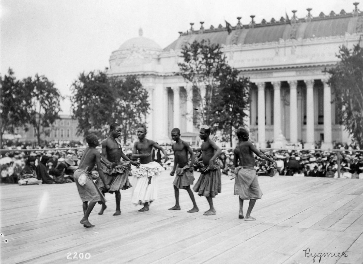 Pygmies from Central Africa dancing on platform in front of the Palace of Manufactures at the 1904 World's Fair on 28 July 1904