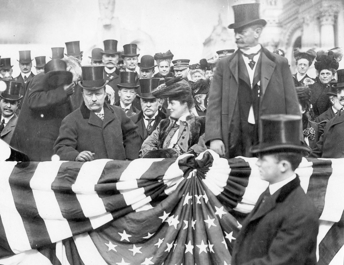President and Mrs. Roosevelt, and David R. Francis, photographed in the reviewing stand on Roosevelt Day, November 26, 1904