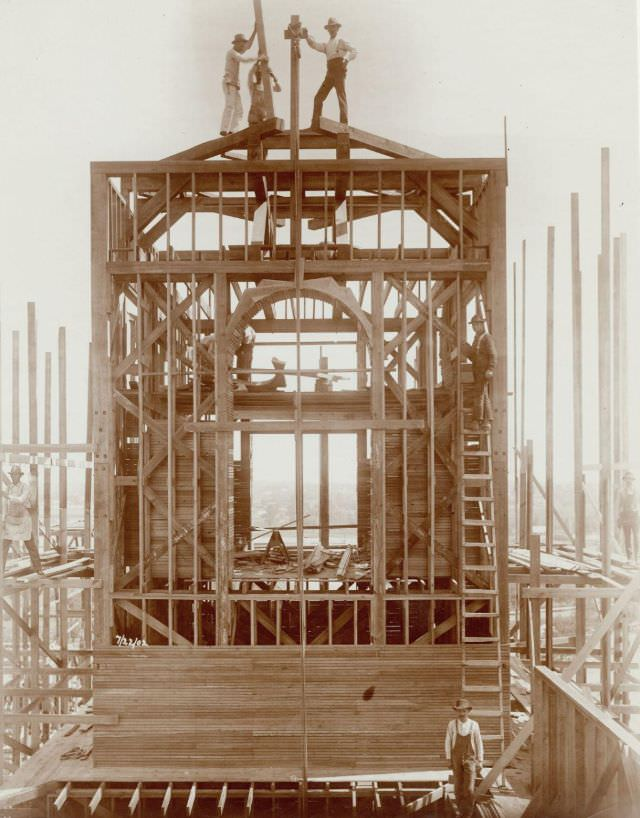 Carpenters at work on the Palace of Varied Industries during construction for the 1904 World's Fair, 1902