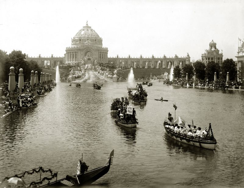 """Floral Parade of All Nations procession on the Grand Lagoon in front of Festival Hall during the 1904 World's Fair. (Gondola with sign """"Visit Asia""""), 1904"""