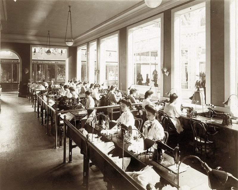 Operators making corsets as part of the Singer Sewing Machine exhibit in the Palace of Manufactures at the 1904 World's Fair, 1904