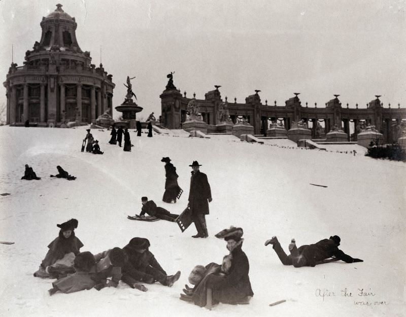 St. Louisans sledding down Art Hill after the 1904 World's Fair was over. The East Restaurant Pavilion and Colonnade of States are still visible in the background, 1904-05