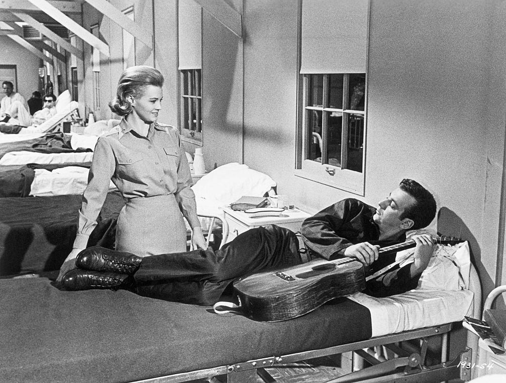 """Angie Dickinson introduces herself to a new patient, Bobby Darin. A scene from Universal's """"Captain Newman, M.D."""