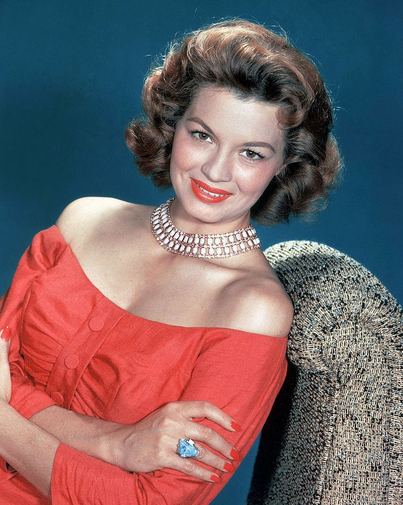Angie Dickinson in red dress and red lipstick, 1955.