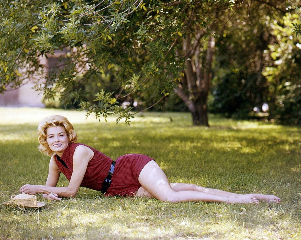 Angie Dickinson in a red playsuit, 1955.