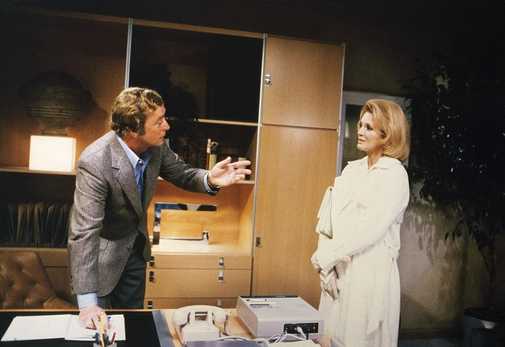 Angie Dickinson with Michael Caine on the set of 'Dressed to Kill', 1960.