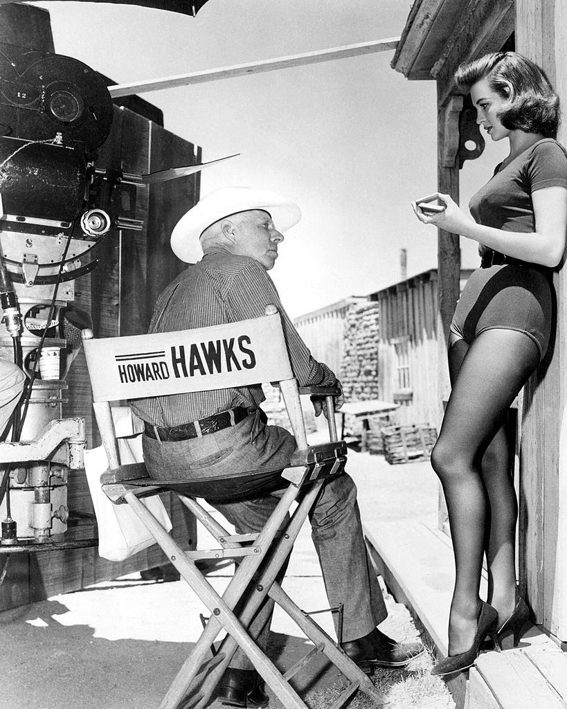 Angie Dickinson with director Howard Hawks  on the set of 'Rio Bravo', 1959.